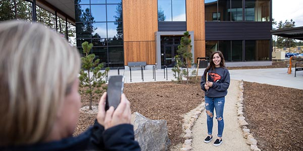 student in front of obsidian hall