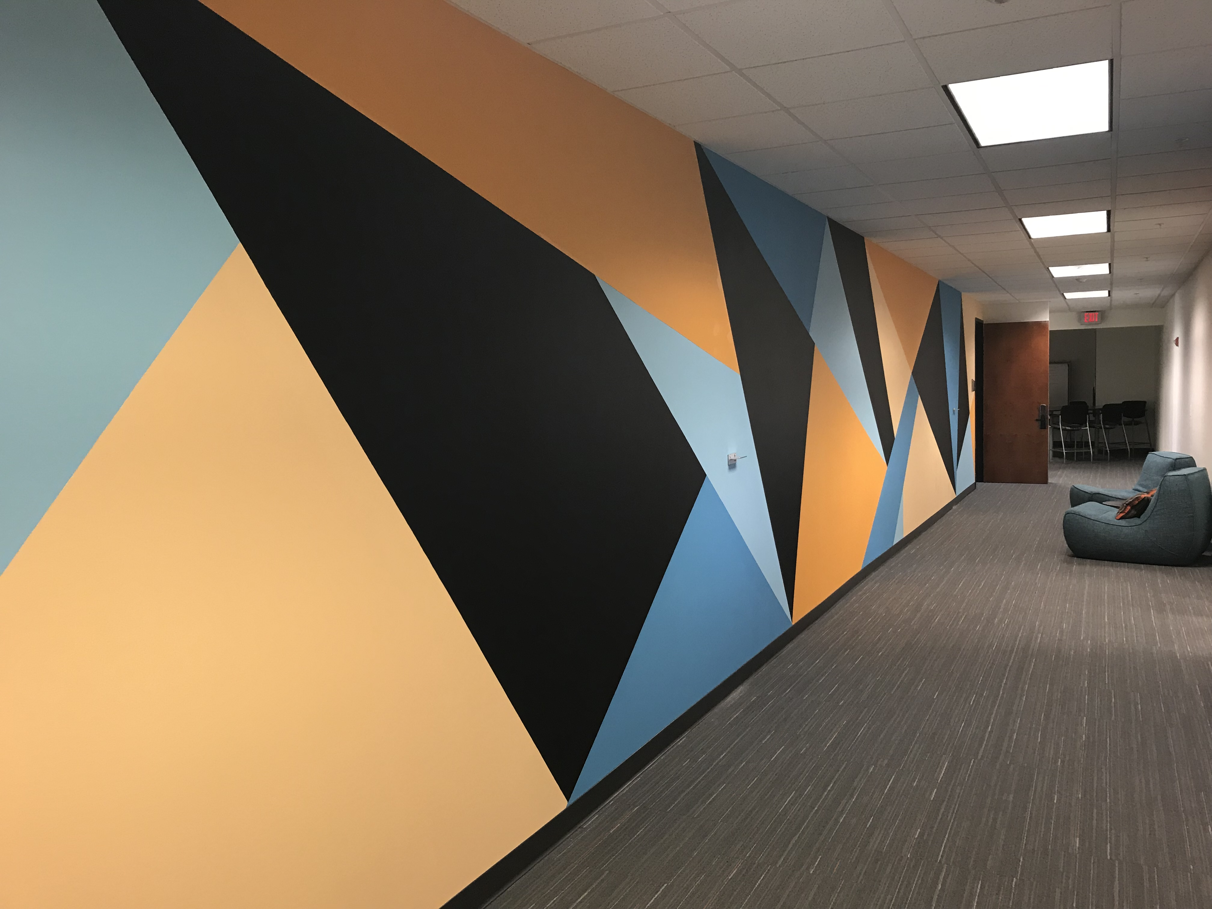 The Mural Outside the Co-Lab:  The Co-Lab space has a variety of co-working desks, whiteboards, conference rooms, event spaces and soft seating areas to fit your needs.