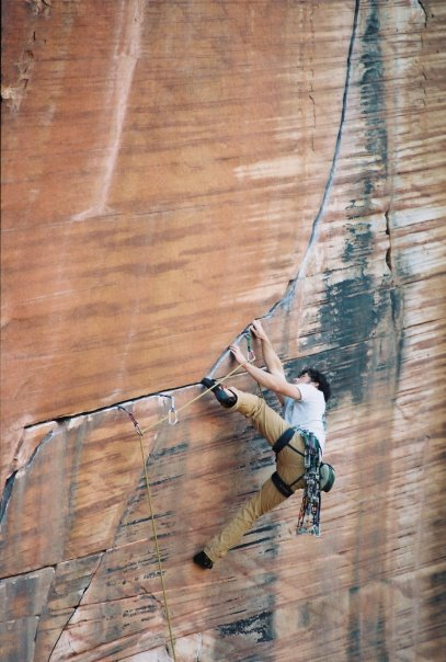 Lead climbing a horizontal sandstone crack