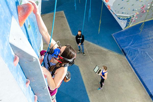 student researcher in rock climb study